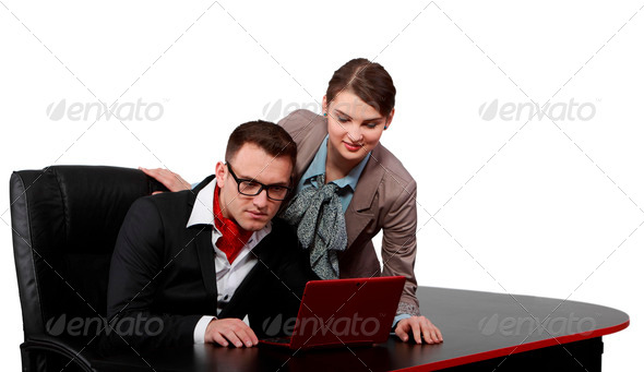 Young Couple on a Notebook  - Stock Photo - Images