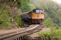Moving train at death railway, Kanchanaburi, Thailand - PhotoDune Item for Sale