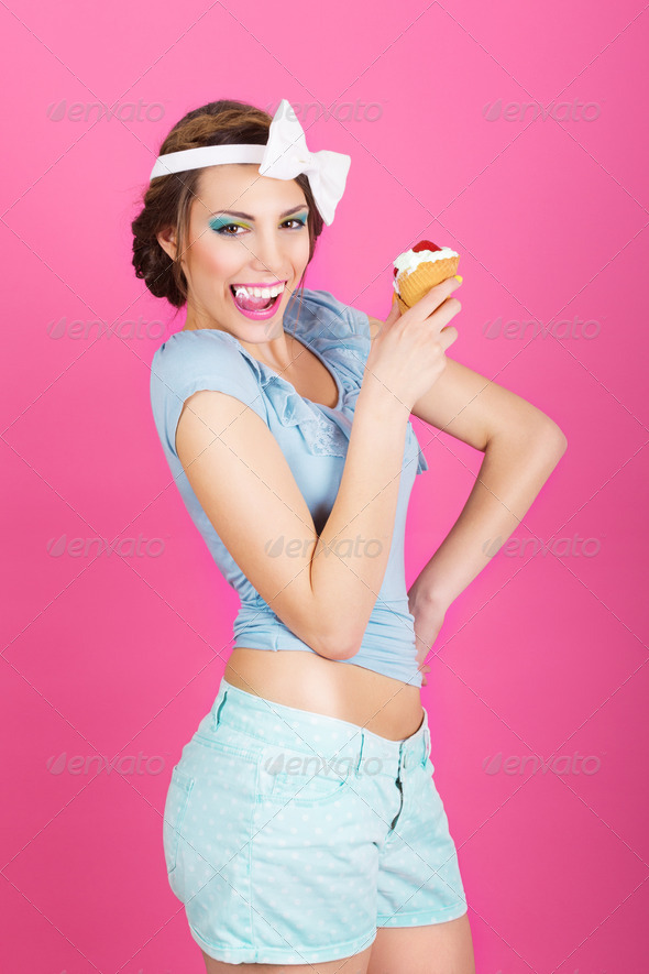 Retro pin-up fashionable brunette with delicious icecream - Stock Photo - Images