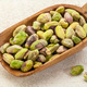 raw pistachio nuts on a scoop - PhotoDune Item for Sale