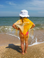 little girl standing at the seacoast - PhotoDune Item for Sale