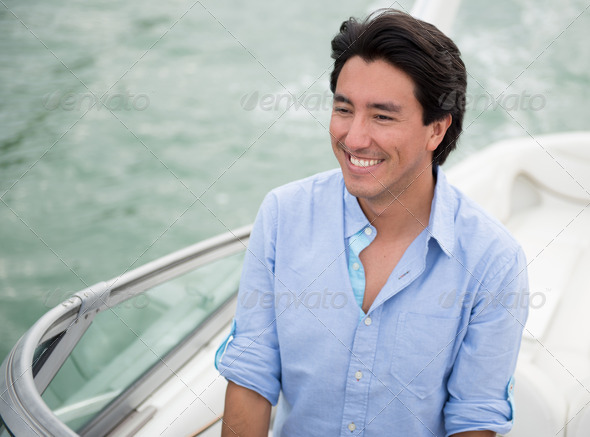Man driving a yacht - Stock Photo - Images