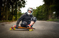 Downhill skateboarder in action - PhotoDune Item for Sale