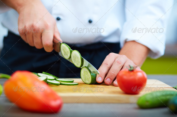 Cutting vegs - Stock Photo - Images
