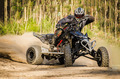 ATV racer takes a turn during a race. - PhotoDune Item for Sale