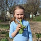little beautiful girl chewing young sprout of rhubard in the spring - PhotoDune Item for Sale