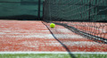 Tennis Ball on Synthetic Ground with Tennis Net - PhotoDune Item for Sale