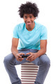 Young black teenage men playing video games - African people - PhotoDune Item for Sale