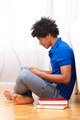 Young african american student using a laptop - African people - PhotoDune Item for Sale
