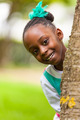 Outdoor close up portrait of a cute young black girl - African p - PhotoDune Item for Sale