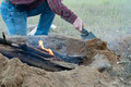 Man Builds Fire Pit Around Open Camp Fire - PhotoDune Item for Sale