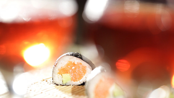 Sushi Rolls And Plum Wine