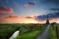 sunrise behind windmill, Netherlands