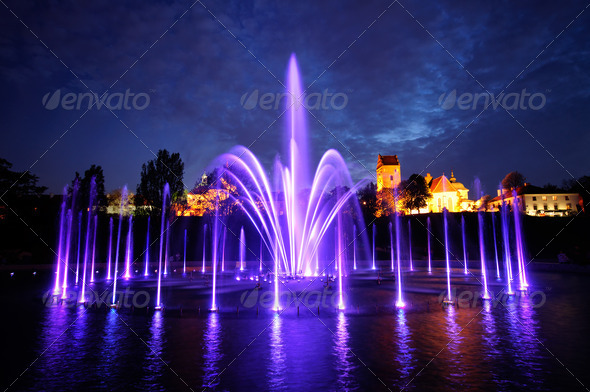 illuminated fountain at night in Warsaw. Poland - Stock Photo - Images