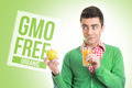 Young man with healthy GMO free juice and apple - PhotoDune Item for Sale