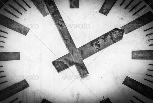 Retro clock face with two hands and no numbers.