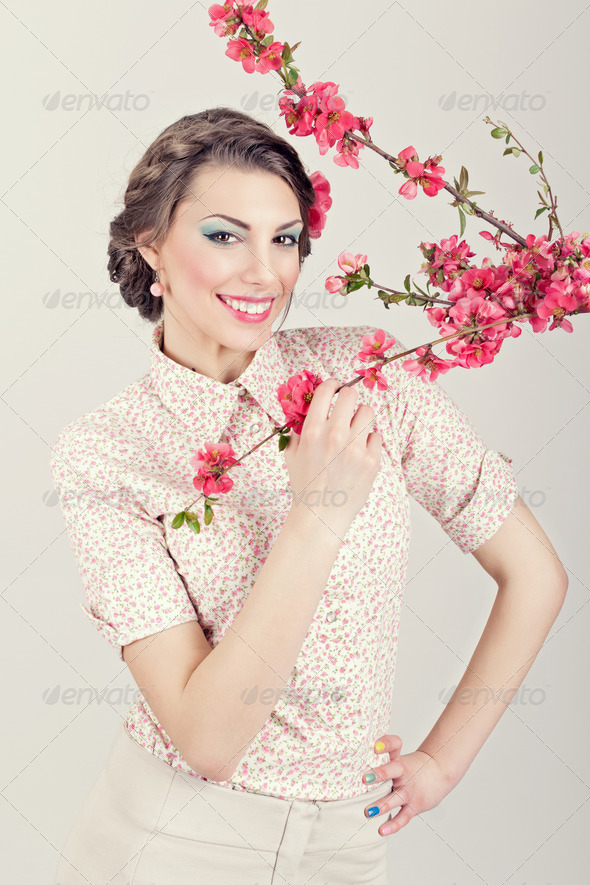 Gorgeous retro styled young woman with pink flowers - Stock Photo - Images