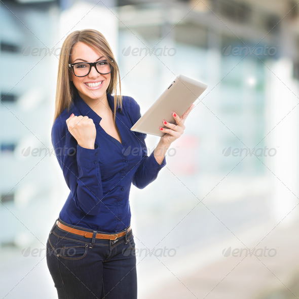 Happy young businesswoman with tablet computer - Stock Photo - Images