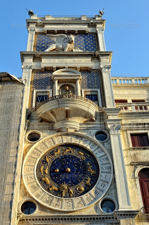 Clock on the wall of the house at St. Mark's Square. - Stock Photo - Images