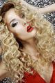 Imagination. Fantasy. Face of Shining Blond Hair Woman. Luxury