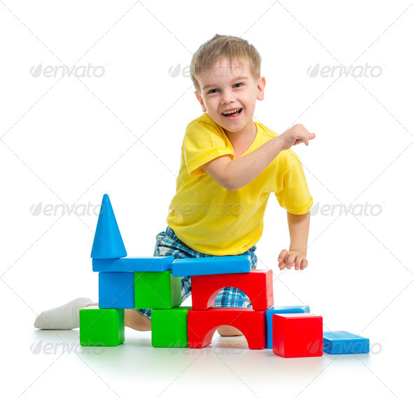 happy kid playing with colorful blocks isolated - Stock Photo - Images