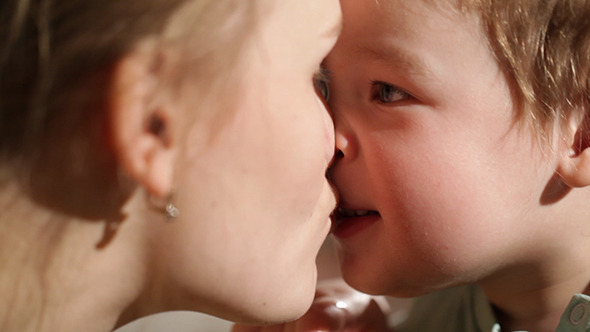 Mom And Her Son Kissing