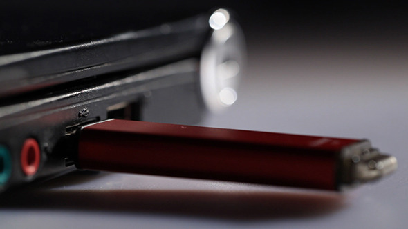 Inserting Red USB Flash Drive In Notebook