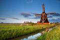 Dutch windmill in morning sunrise sunlight