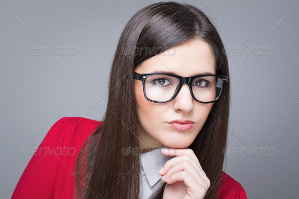 Confident businesswoman wearing glasses - Stock Photo - Images