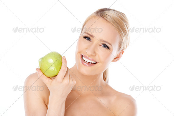 Adorable and healthy woman holding apple - Stock Photo - Images