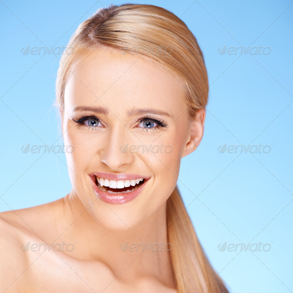 Beautiful girl with big smile on blue - Stock Photo - Images