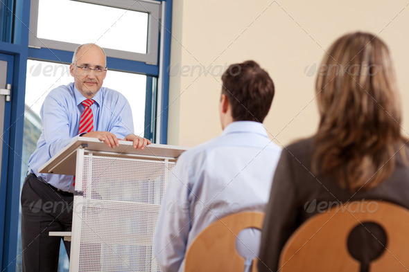Businessman Giving Presentation - Stock Photo - Images