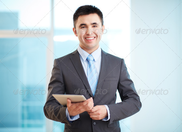 Businessman with touchpad - Stock Photo - Images