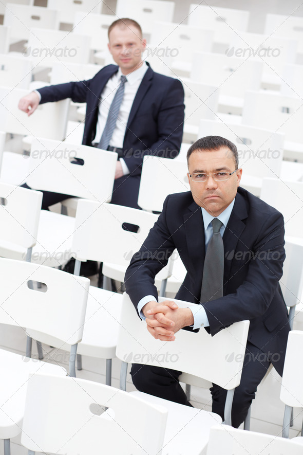 Businessmen in conference hall - Stock Photo - Images