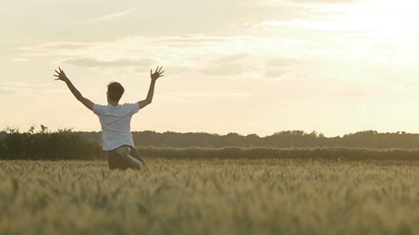 Men Running Through Wheat Field 3
