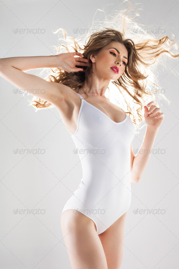 beautiful woman with perfect body dressed in white body-wear - Stock Photo - Images