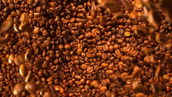 Download Roasted Coffee Beans Falling Down Into A Pile nulled download