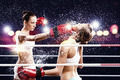 Two women boxing in ring - PhotoDune Item for Sale