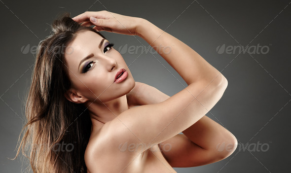 Beautiful woman posing with hands in her hair - Stock Photo - Images