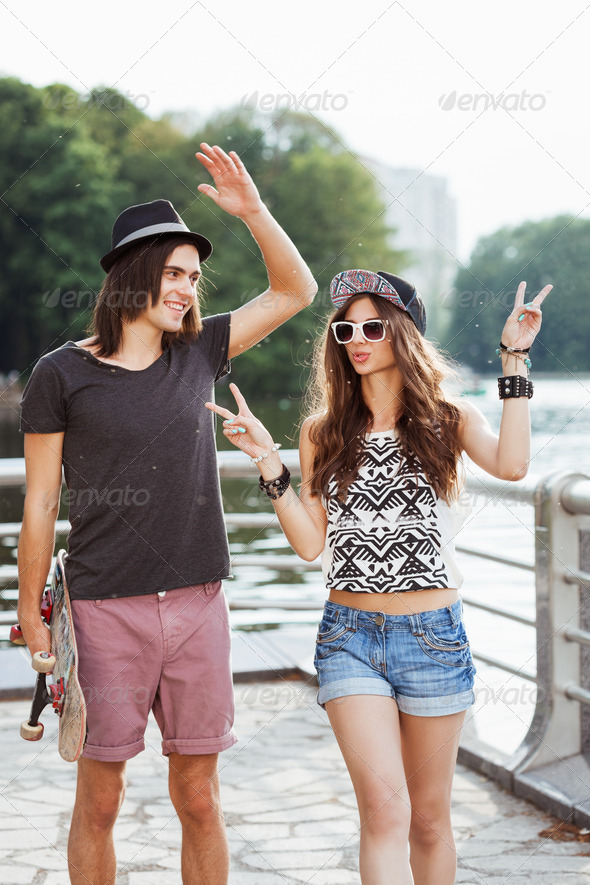 Yong couple  on the bank of a river - Stock Photo - Images