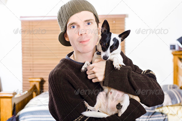 Young man with his little boy dog - Stock Photo - Images