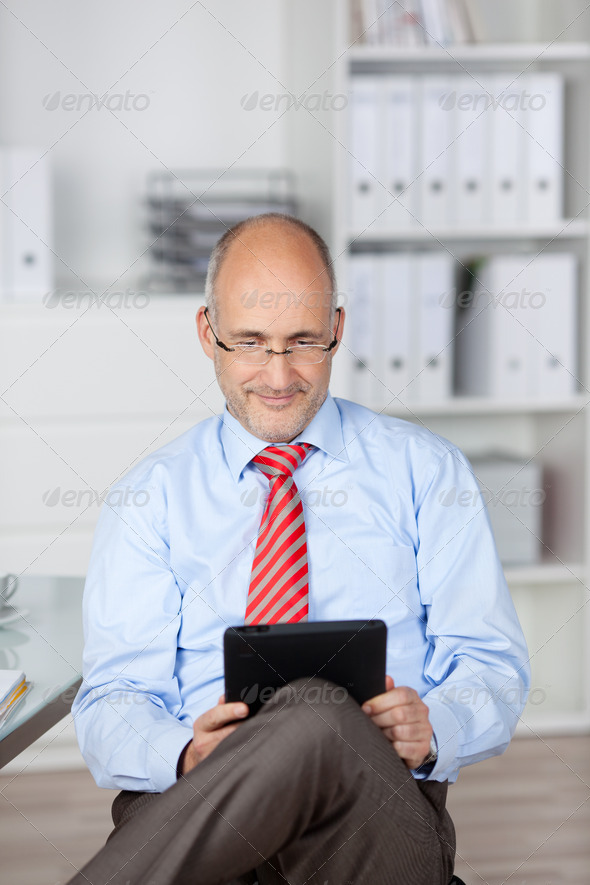 Bald man with tablet computer - Stock Photo - Images