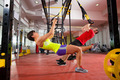 Fitness TRX training exercises at gym woman and man - PhotoDune Item for Sale
