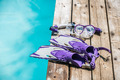 Diving goggles, snorkel and fins on the jetty - PhotoDune Item for Sale
