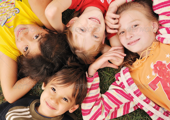 Small group of happy children outdoor - Stock Photo - Images