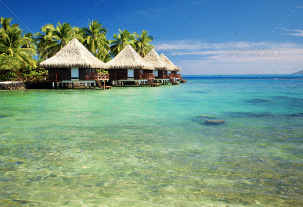 Over water bungalows with steps into amazing lagoon - Stock Photo - Images