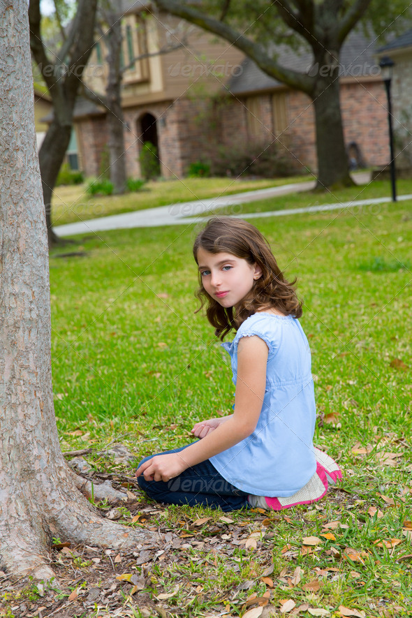 beautiful kid girl smiling sitting on park lawn relaxed - Stock Photo - Images