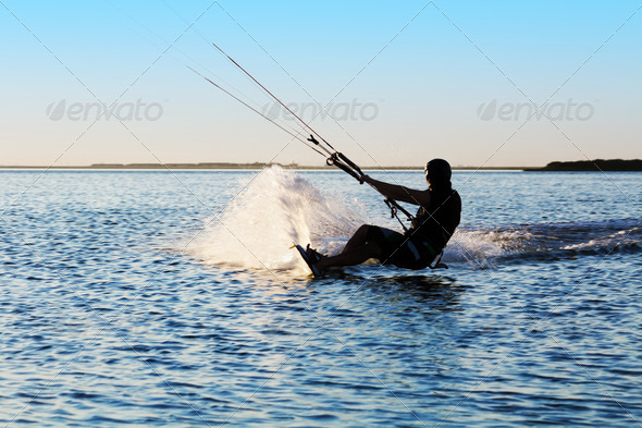 Silhouette of a kitesurfer - Stock Photo - Images