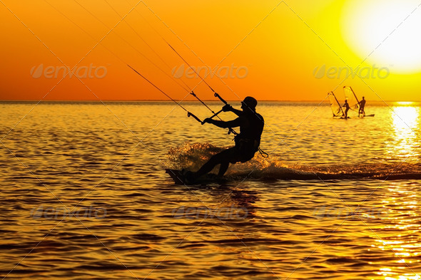 Silhouettes of a windsurfers - Stock Photo - Images