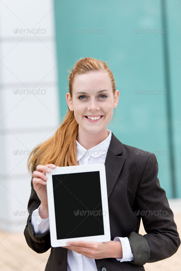 Businesswoman Showing Tablet PC - Stock Photo - Images